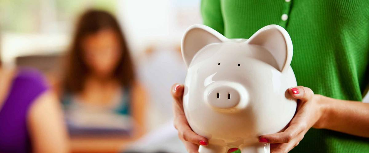 Students: Female Student Holding Piggy Bank