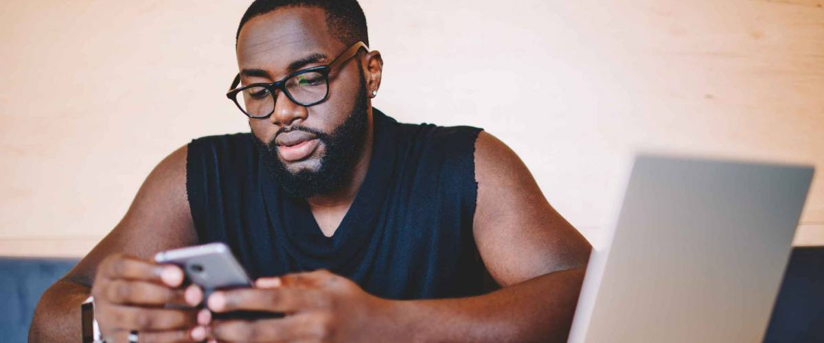 Serious african american male freelancer reading information