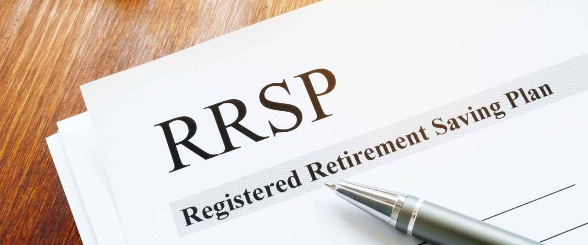RRSP Registered Retirement Saving Plan documents on table.