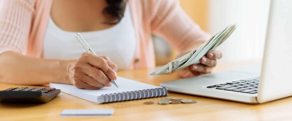 Woman distributing family budget