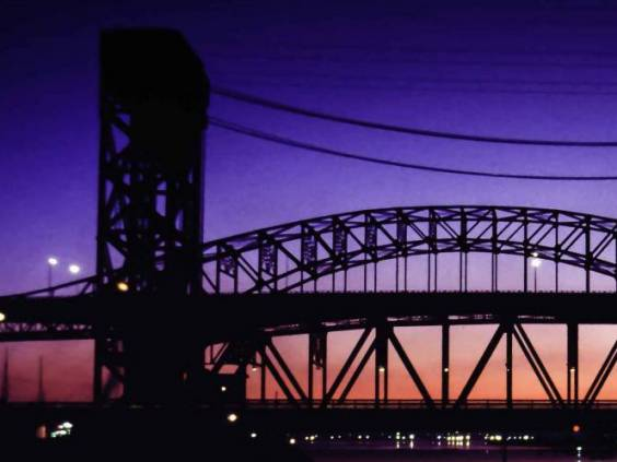 Hamilton Harbour Lift Bridge at twilight with lights reflecting off the water