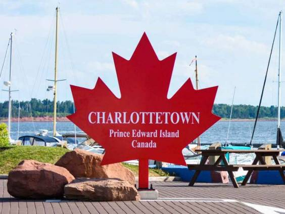 Charlottetown sign on the red maple leaf at the port harbor in Prince Edward Island, Canada.