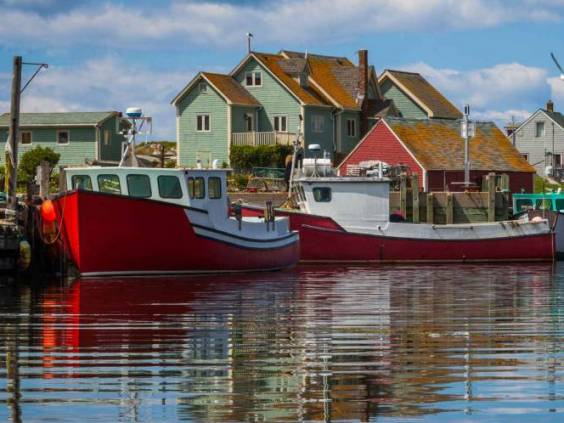 Summer view of fishermen houses and harbor at Peggy's Cove, Nova Scotia, Canada.