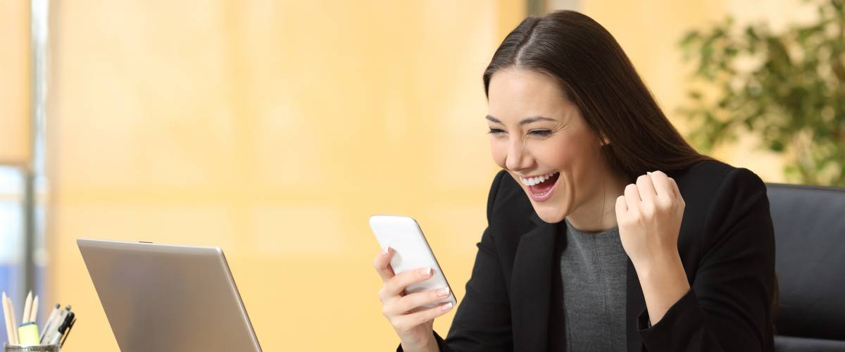 Excited woman checking phone
