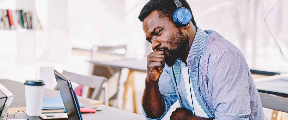 Young african american hipster guy in headphones
