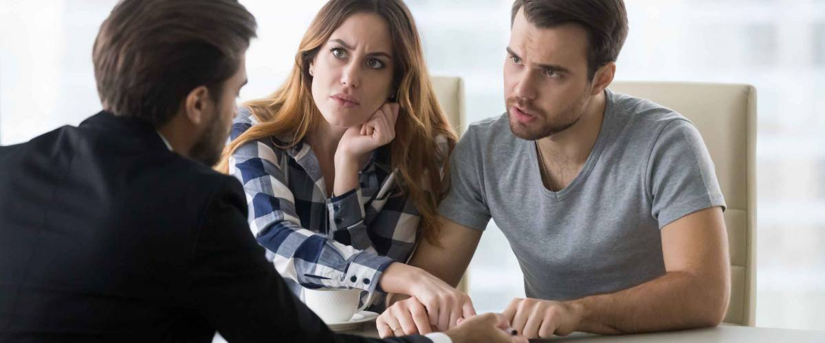 Dissatisfied couple arguing with insurer