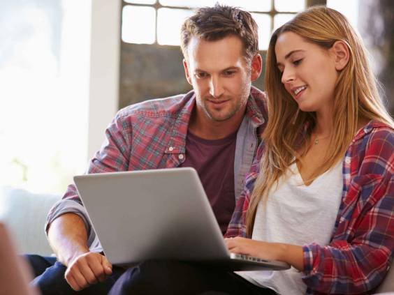 Couple looking at investment portfolio together.