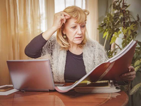 Senior blonde business woman unhappy with the numbers she's reviewing