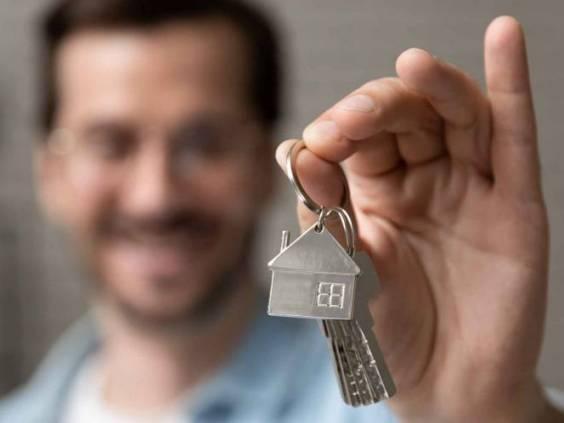 Satisfied homeowner holding keys.