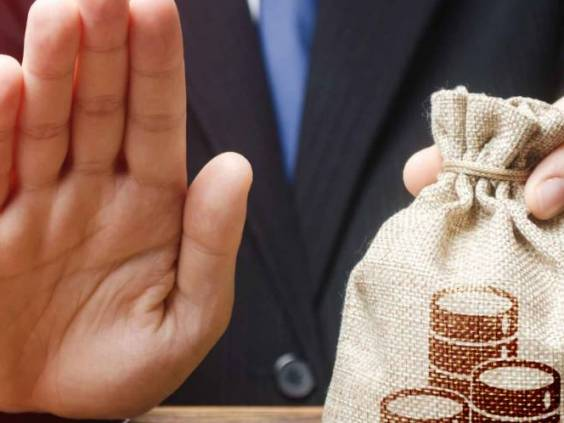 Businessman refuses to give money bag.