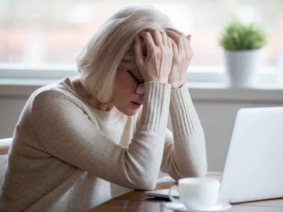 Upset depressed mature middle aged woman in panic