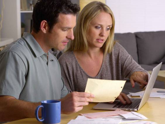 Couple doing their finances with laptop