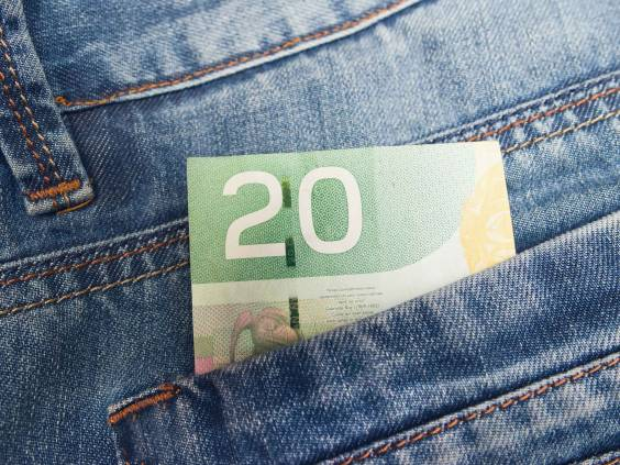Canadian money in a pocket.