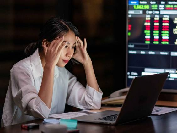 Young asian woman, owner watch investment data in laptop.