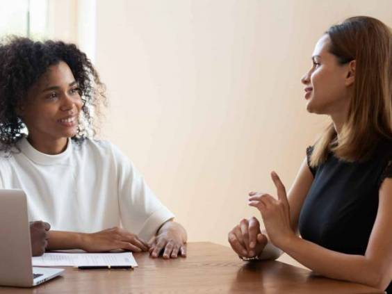 Female broker makes offer to young African ethnicity married couple