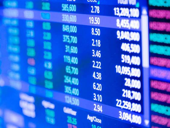 Closeup Display of Stock market quotes with city scene reflect on glass of LED, stock market graph on the screen, Business, finance or investment background concept
