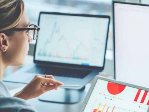 Woman studying financial graphs