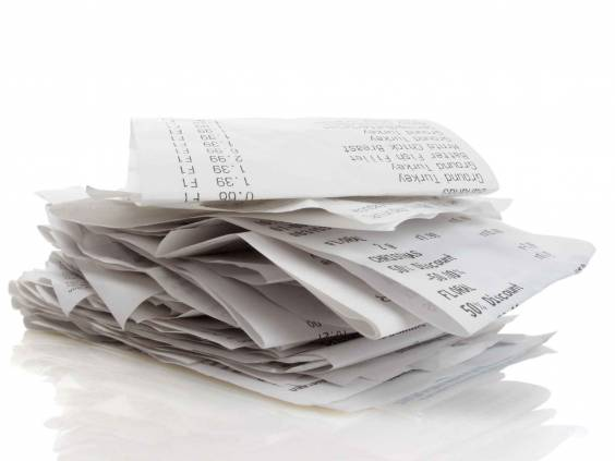 Stack of receipts piled high on white background