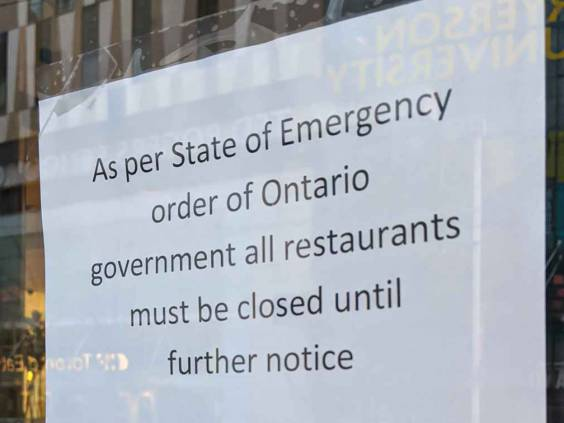 Toronto, Ontario - Mar 19, 2020: Sign on a restaurant door during covid 19 outbreak as per state of emergency order of Ontario government all restaurants must be closed until further notice.