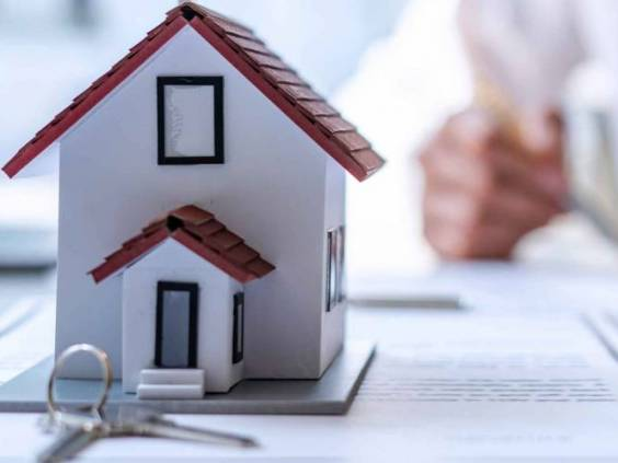New homebuyers are signing a contract to buy or sell a home at an agent's desk to meet the deal, purchase contract concept. Or selling houses and land