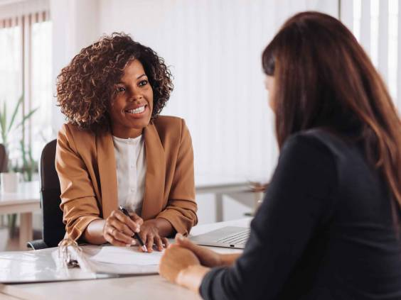 Woman consulting with a female financial manager at the bank