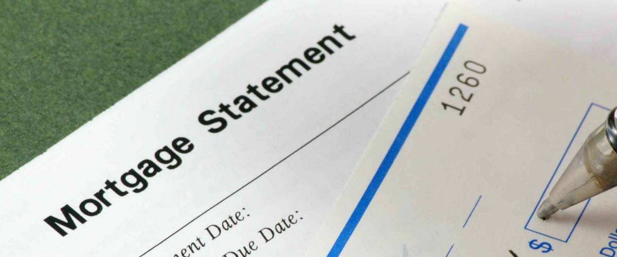 Writing a check for the mortgage payment