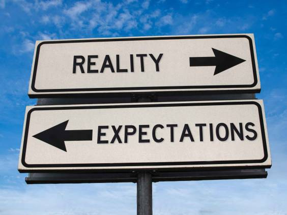 Reality vs. expectations, as portrayed in two street signs
