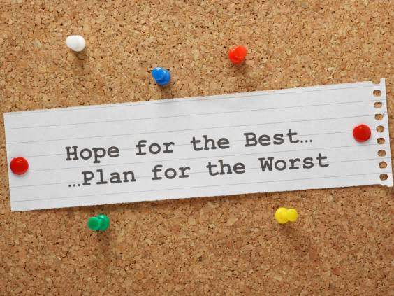Hope for the Best, Plan for the Worst typed out on a scrap of paper and tacked to a cork board