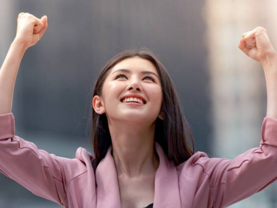 Asian woman happy about her raise
