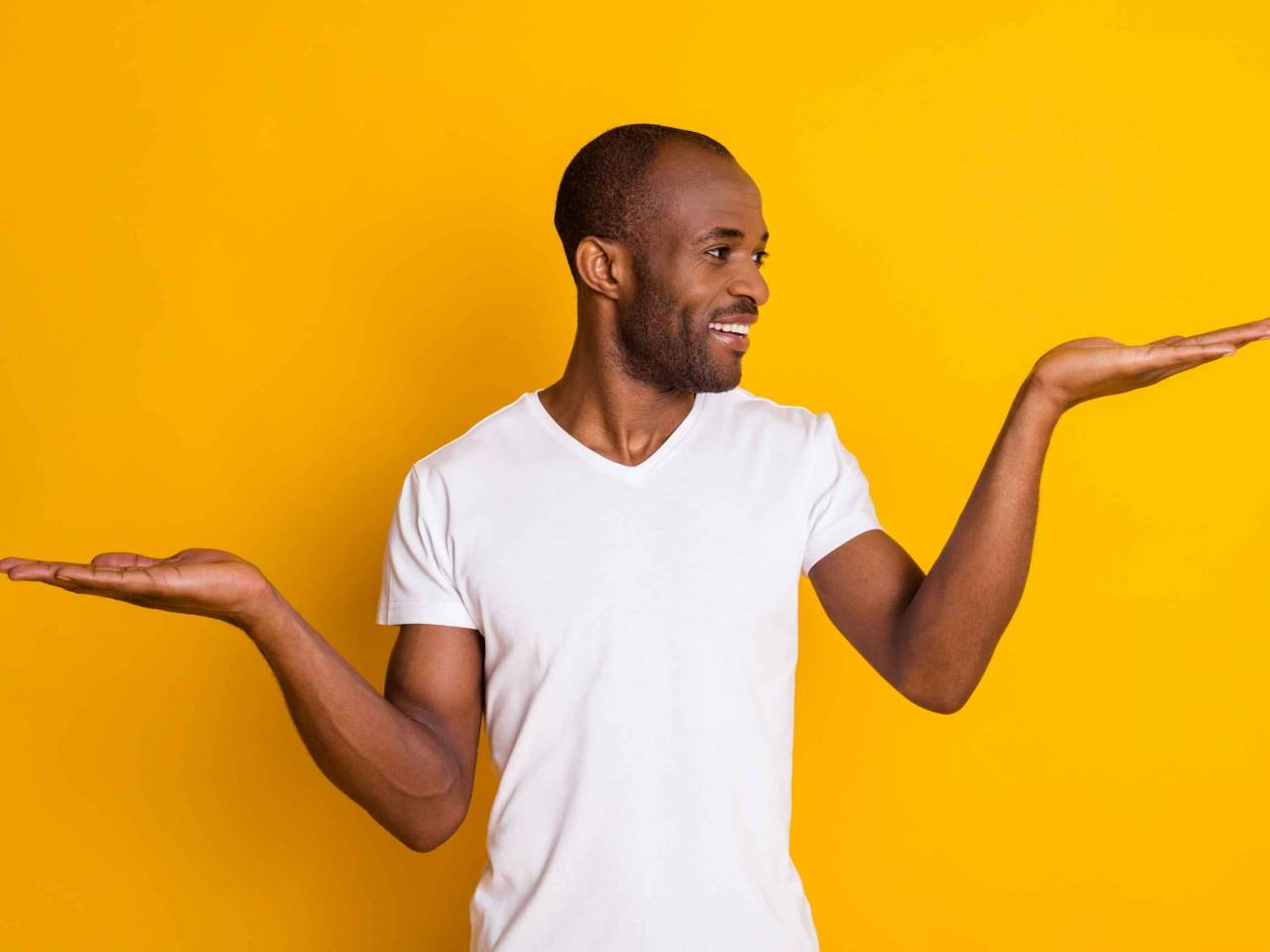 Portrait of positive afro american guy hold hand demonstrate ads promo recommend suggest select wear casual style clothes isolated over bright color background