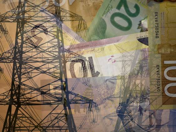 High voltage electric tower or pylon with high power lines on 100, 20, 10 and 5 Canadian dollar bills, double exposure shot with money and technology