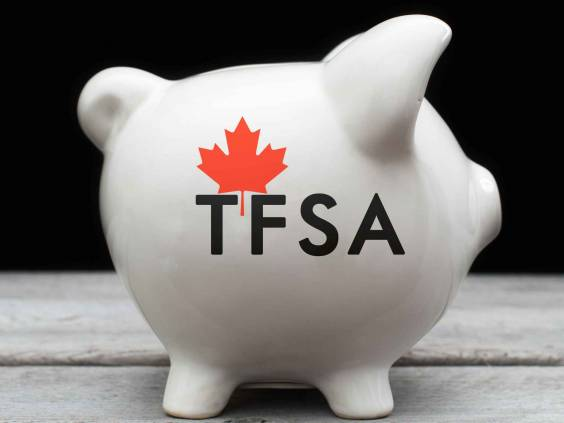 Canadian Tax-Free Savings Account concept with a piggy bank against black background