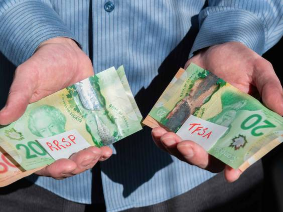 Close-up of man's hands holding Canadian cash for RRSP and TFSA investments