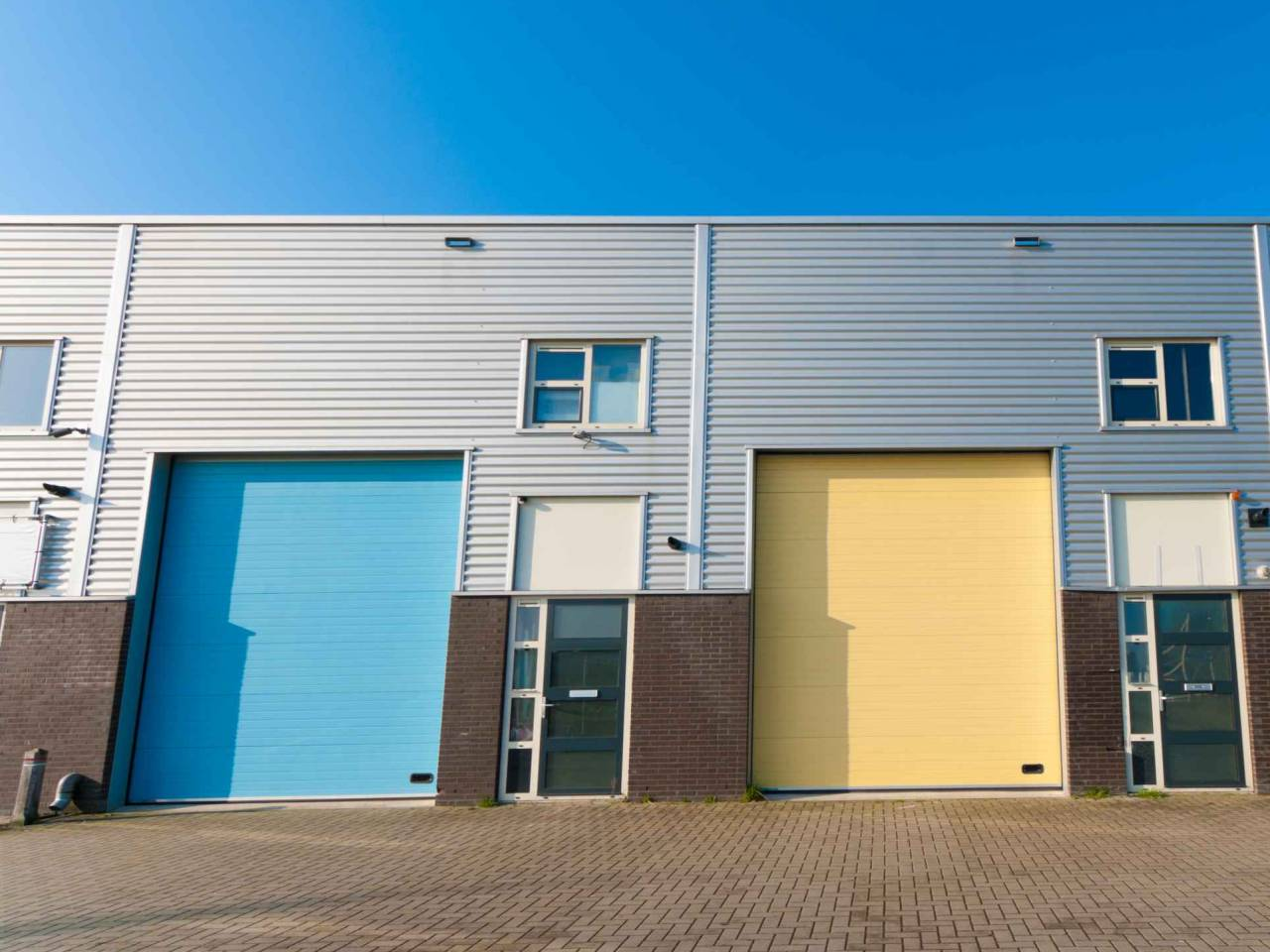 business units for small companies with colorful roller doors