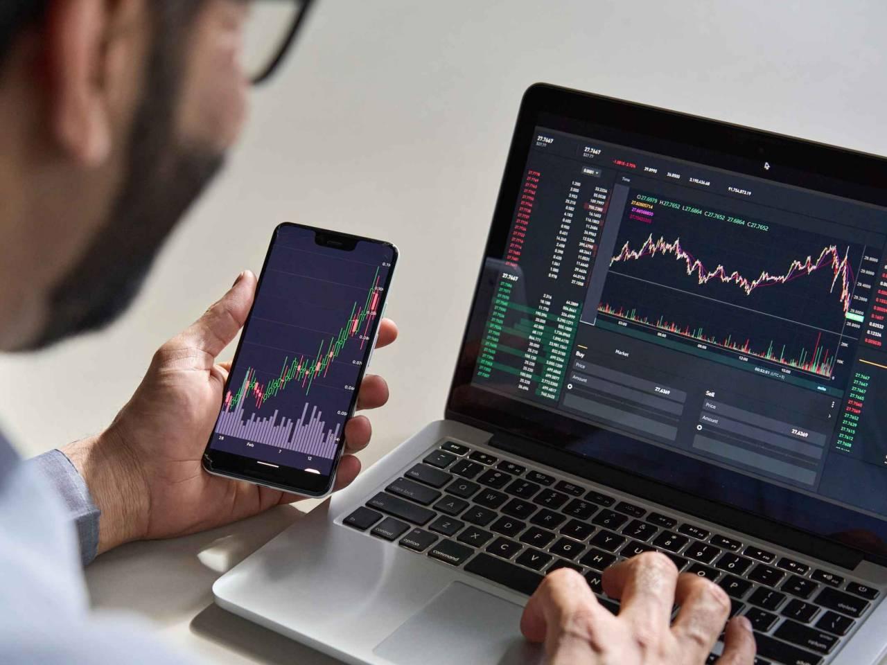 Business man trader investor analyst using mobile phone app analytics
