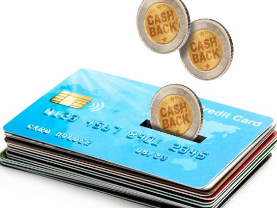 Coins Cashback falls into a credit card. Refund. Bonus payments after the purchase. Isolated on a white background.