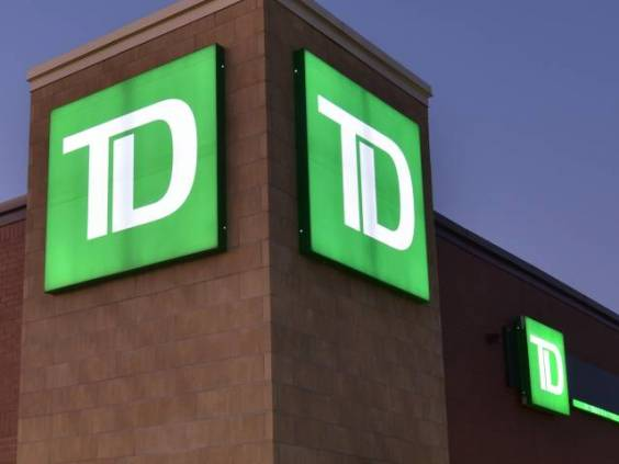 View of TD bank location from outside at night.