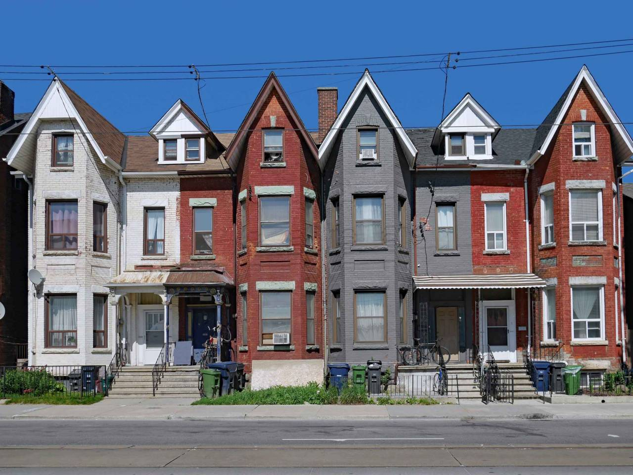row of old Victorian urban houses with gables
