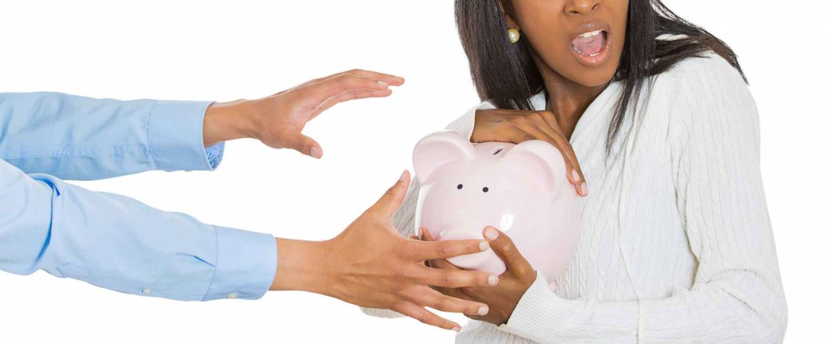 portrait young shocked woman holding piggy bank