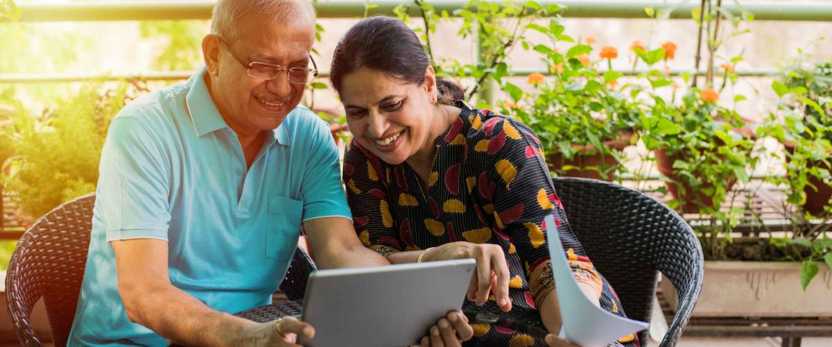 Senior Indian couple doing home finance