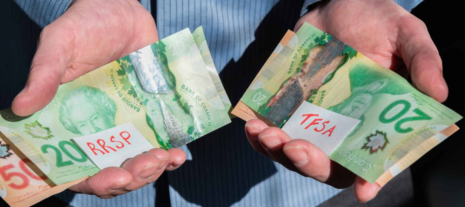 Man holding money labelled RRSP and TFSA