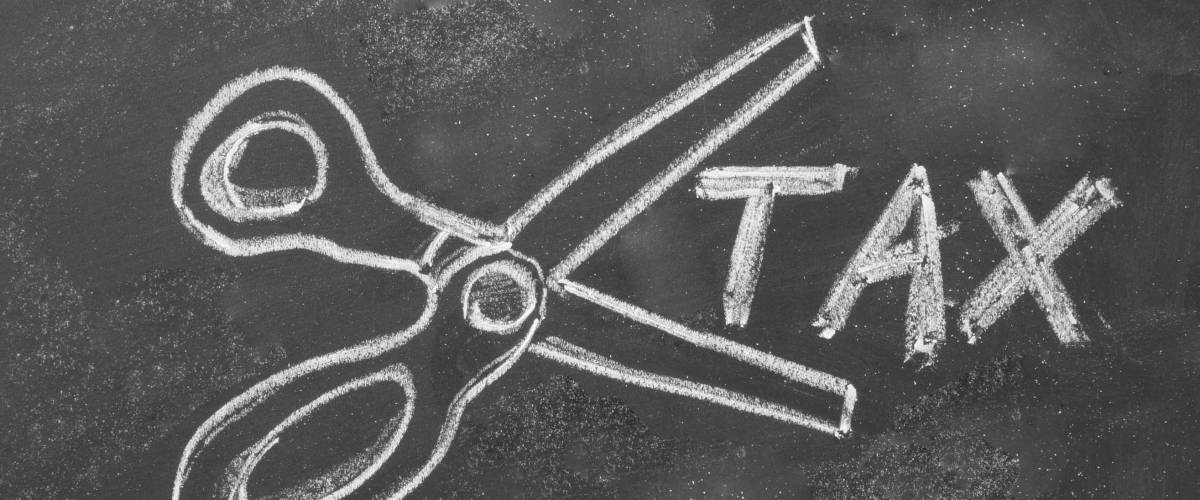 blackboard drawing above shows one scissors cut taxes
