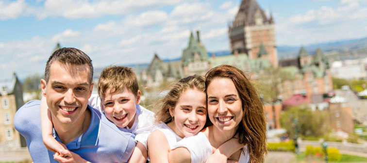 family in summer season in front of Chateau frontenac Quebec